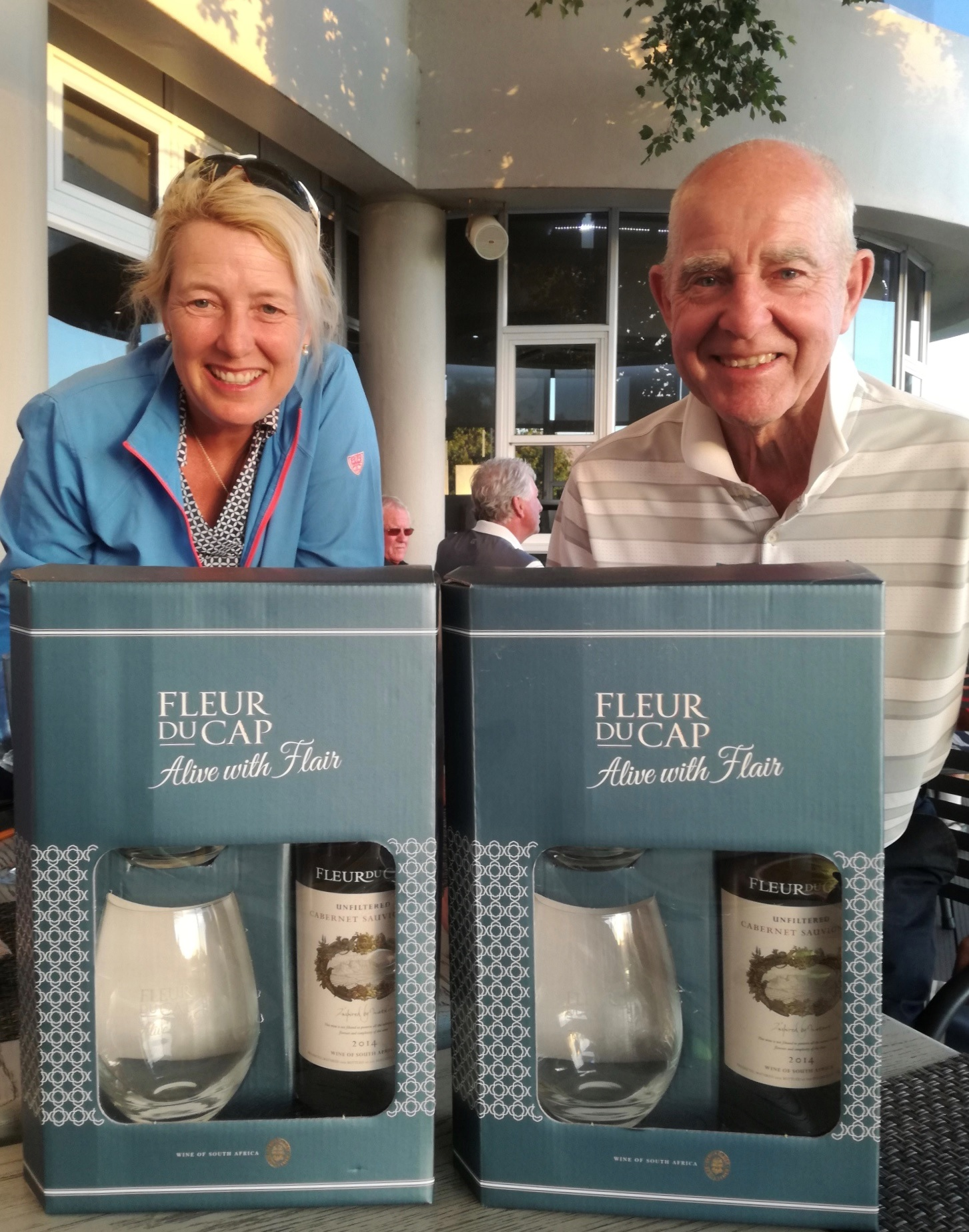 Winning pair Denise Codrington and Roger Clark from Bransford Golf Club with their prizes