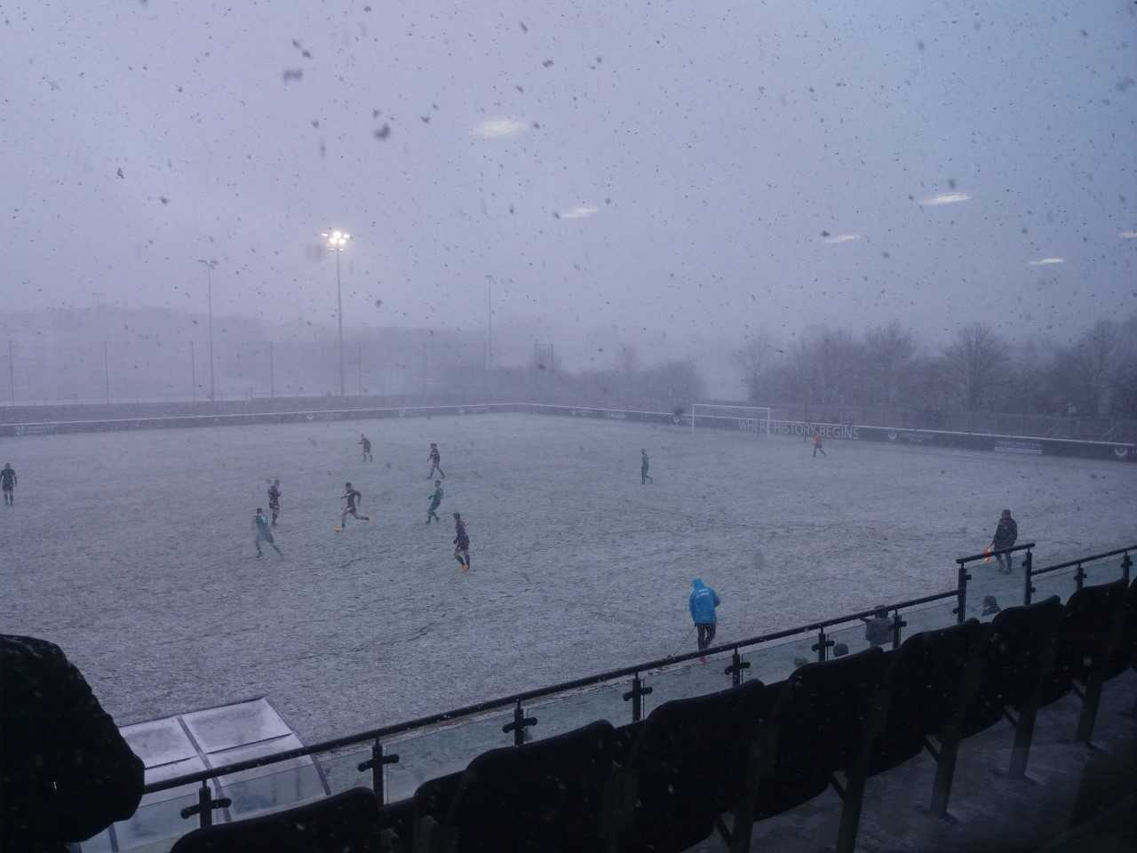 Worcester City and Loughborough University play through the snow. Picture: ANDY MITCHELL