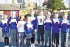 Suckley Primary School pupils with their individual letters from the Prince of Wales.