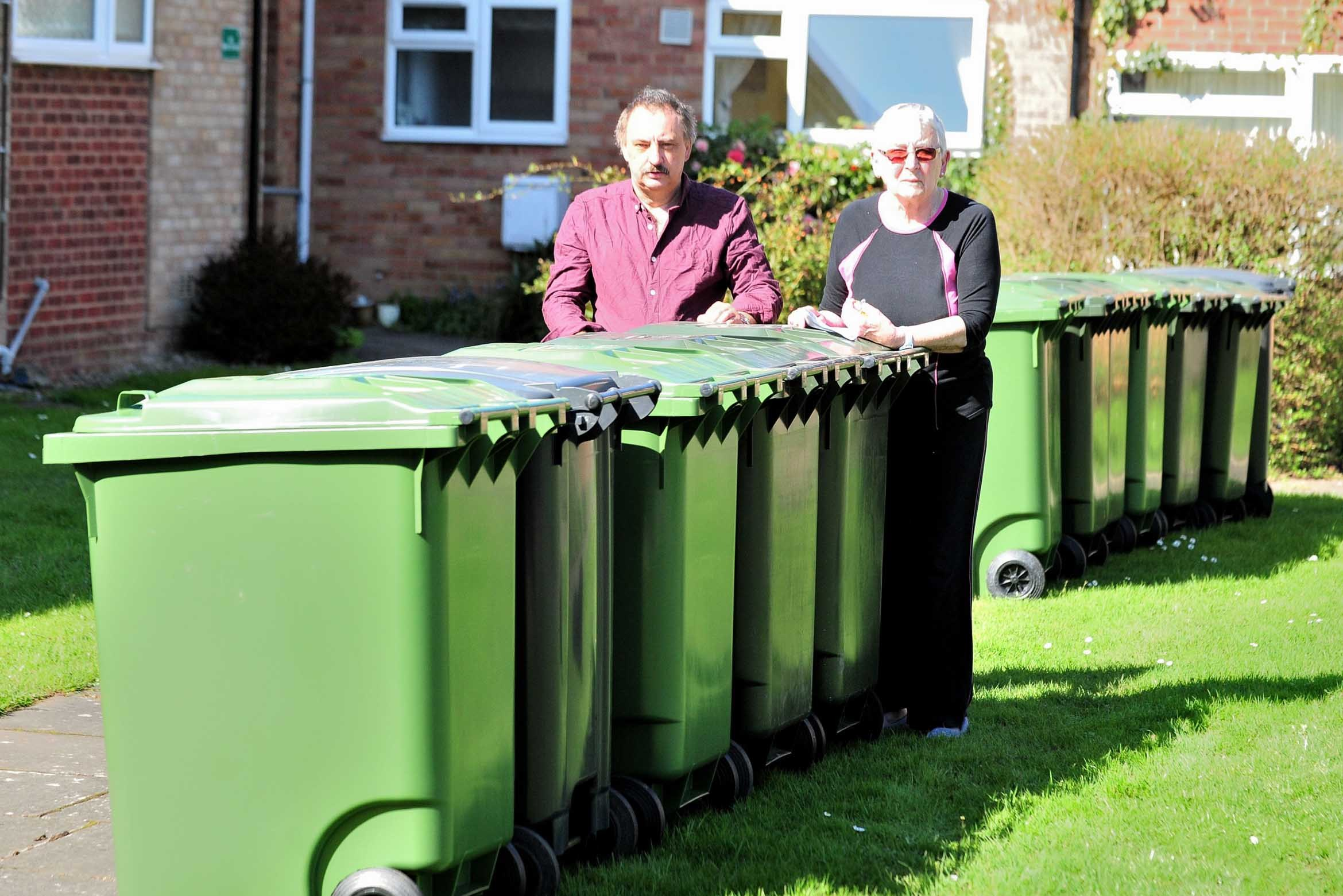 Brook Farm Drive residents Ann Clack and Geoff Howlett with the  array of wheelie bins outside their homes in Malvern. 18.4.18.