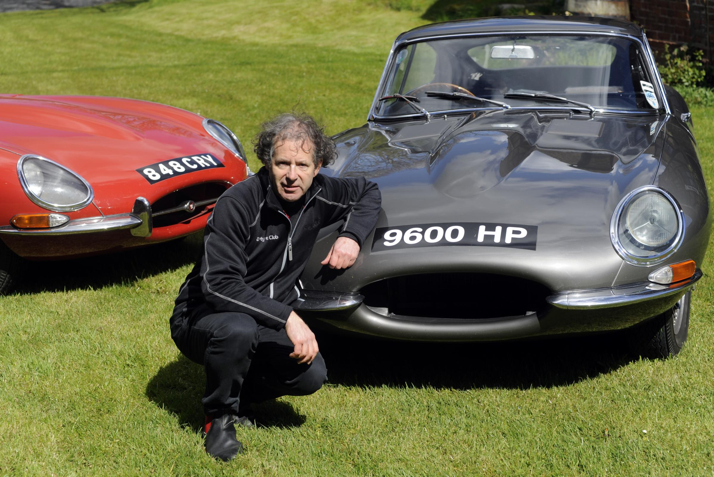 DRIVING: Philip Porter with his beloved E-type Jaguars. The car on the right is the first production E-type. Picture: Abigail Humphries.