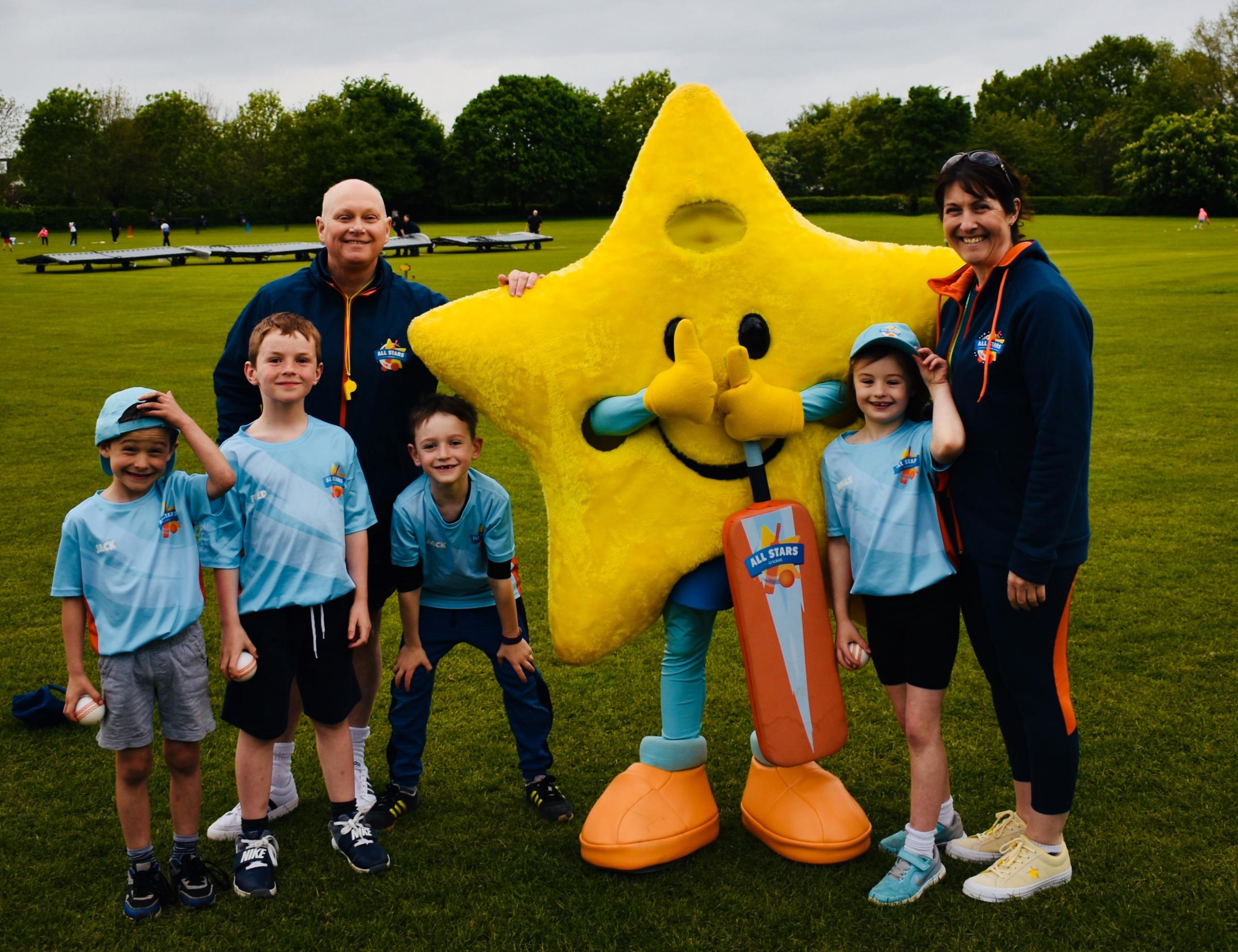 Mascot Twinkle with Droitwich's All Stars activators Chris Green and Claire Cowlard and youngsters