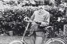 Elgar with bicycle.