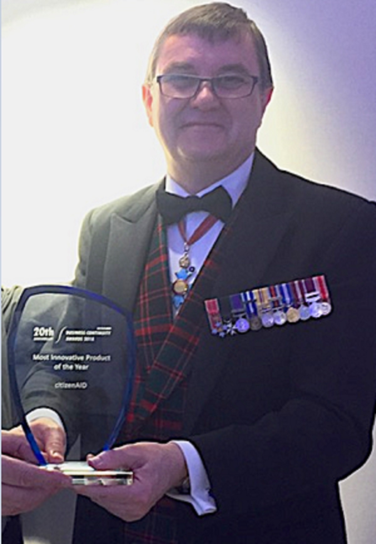 WINNER CitizenAID co-founder, Brigadier Tim Hodgetts, holding the award