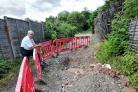 Ted Pratt surveys the hole, which has been dug on the access road to his garage, near his home on Brookside Road, Dines Green. Pic Jonathan Barry 17.7.18.