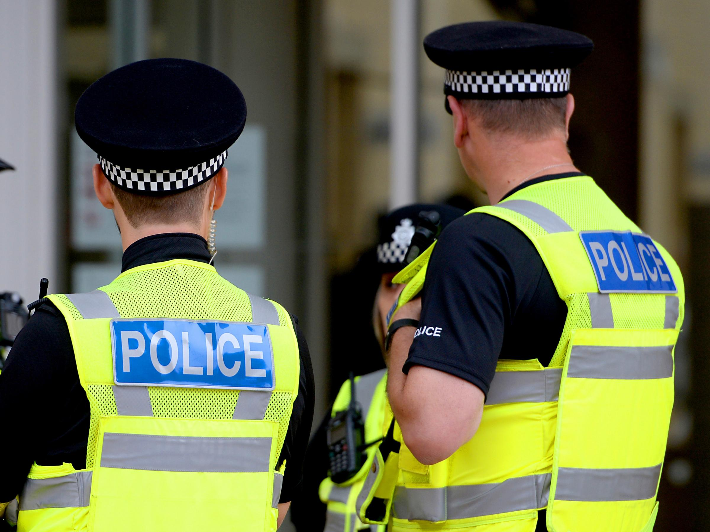 Embargoed to 0001 Tuesday August 07 File photo dated 15/09/16 of police officers. Nearly one in 12 rank-and-file police officers has taken a second job to boost their income, new research suggests.