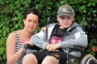 Jill Herdman with her son Sam, 10, who is being treated for cancer, pictured at their home on Blackpole Road, Worcester. Vandals kicked the passenger side mirror off Jill's car...Pic Jonathan Barry 15.8.18.