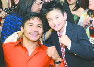 BIG HITTERS: Charlie Green meeting Manny Pacquiao during a recent visit to the Philippines.