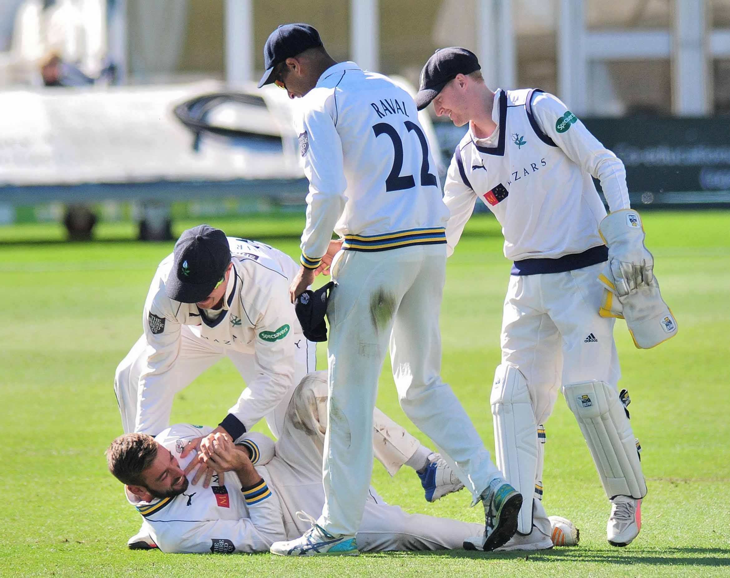 Action from day three of Worcestershire's County Championship match against Yorkshire at New Road, Worcester......Yorkshire players including Tom Kohler Cadmore (Top lft) congratulate Jack Leaning after he caught Ed Barnard for 0, from a Ben Coad deli