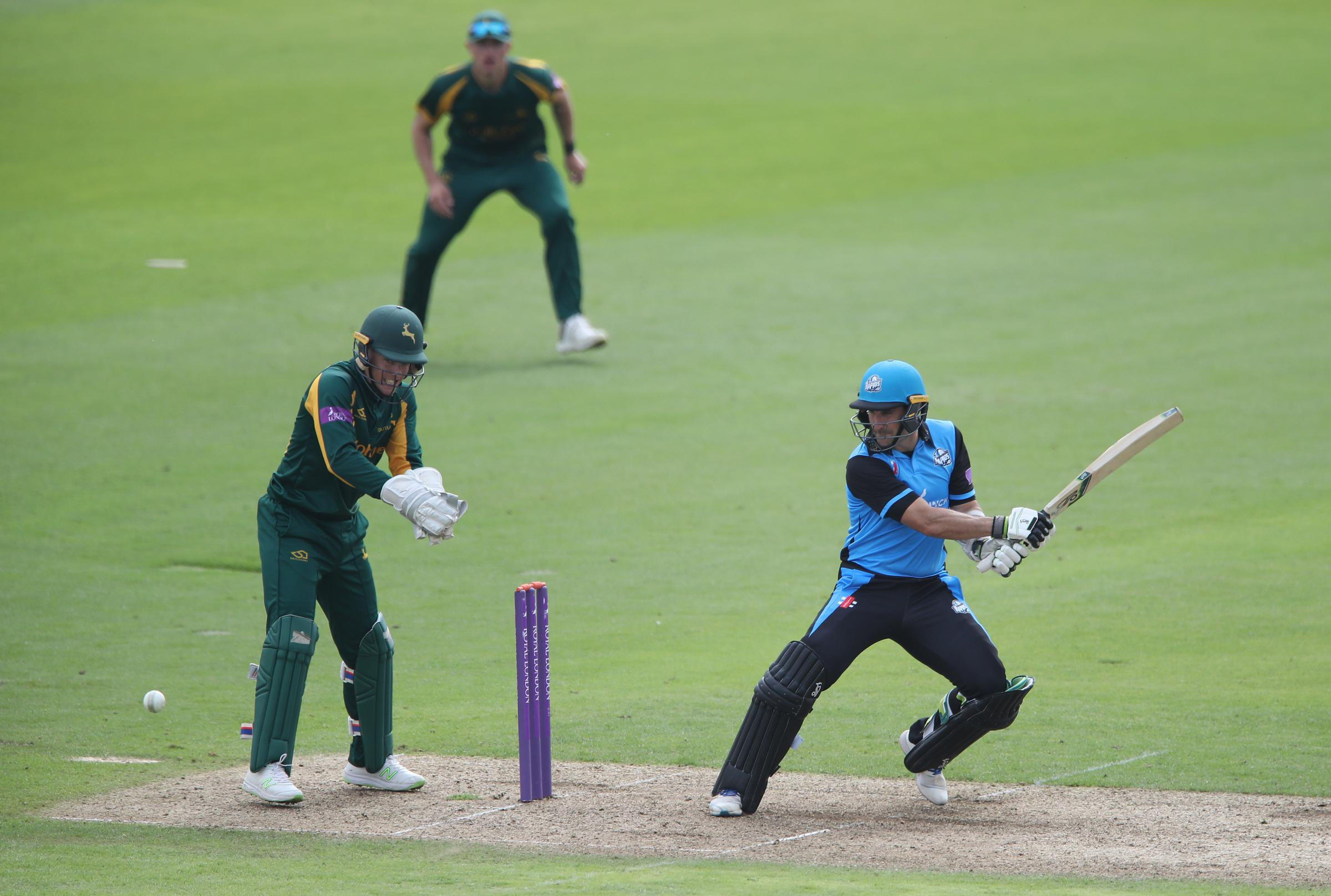 Worcestershire's Daryl Mitchell hits the ball past Nottinghamshire wicketkeeper Tom Moores during Royal London One Day Cup north group match at Trent Bridge, Nottingham.