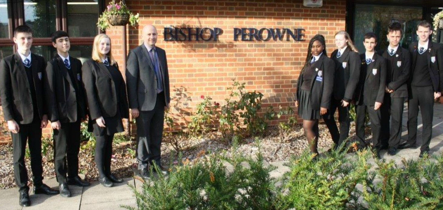 DELIGHTED: Headteacher Mark Pollard with Bishop Perowne pupils after the 'good' Ofsted rating