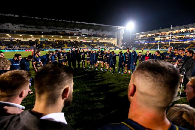 HUDDLE: Victorious Warriors gather at full-time. PIC: Robbie Stephenson/JMP