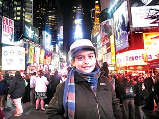 TOP OF THE POPS: Charlie Green takes a break from his US tour to enjoy the sights in Time Square, New York.