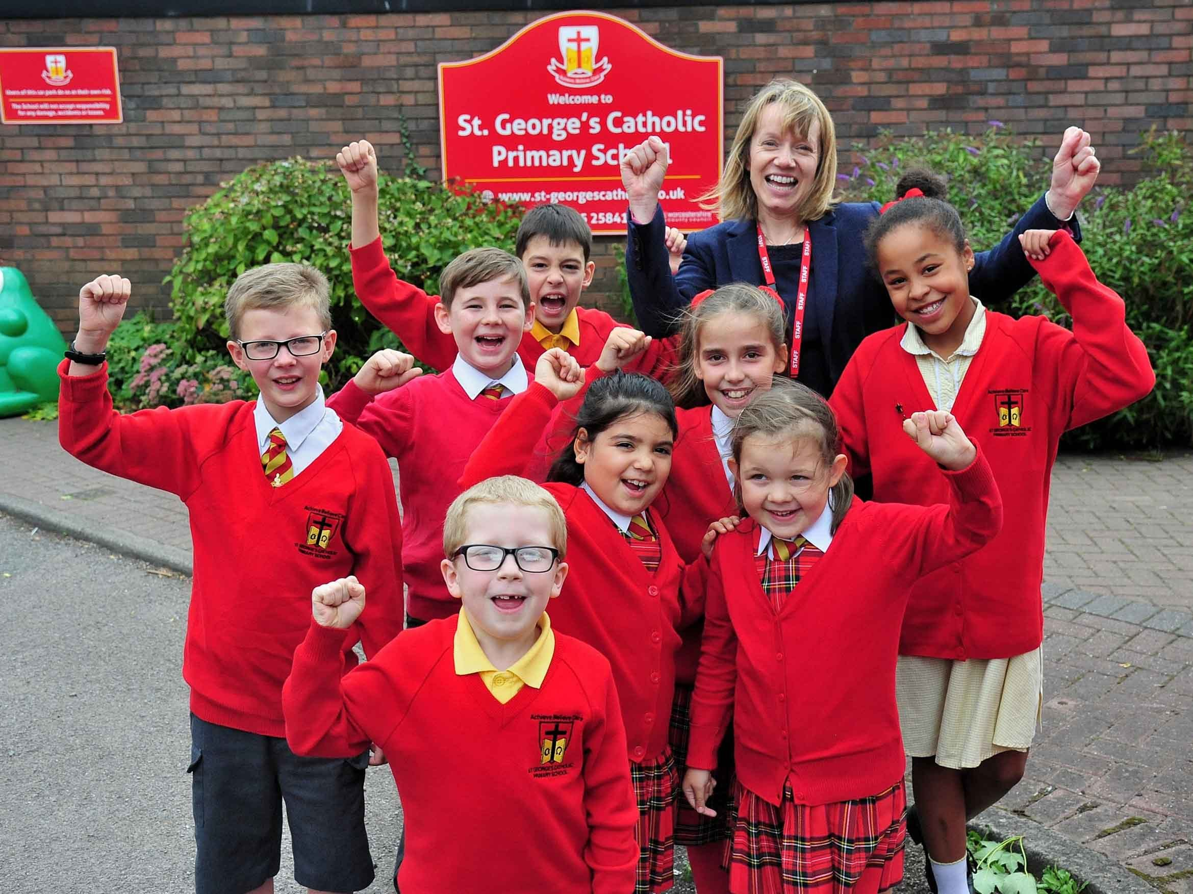 Gill Gittins, Headteacher at St Georges Catholic Primary School, Worcester, with pupils celebrating their recent OFSTED report. Pic Jonathan Barry 19.09.18.