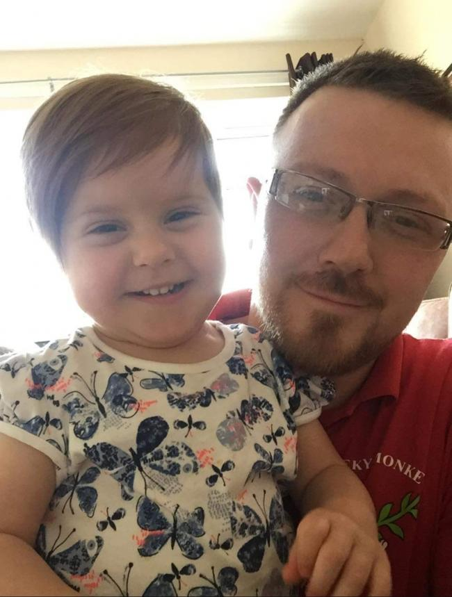 STILL SMILING: James Beresford and his two-year-old daughter Sophie remain positive despite facing a barrage of abuse from a Royal Mail worker