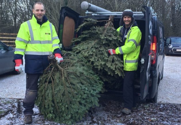 COLLECTION: Employees from Rock Power Connections volunteering for St Richard's Hospice by collecting Christmas trees