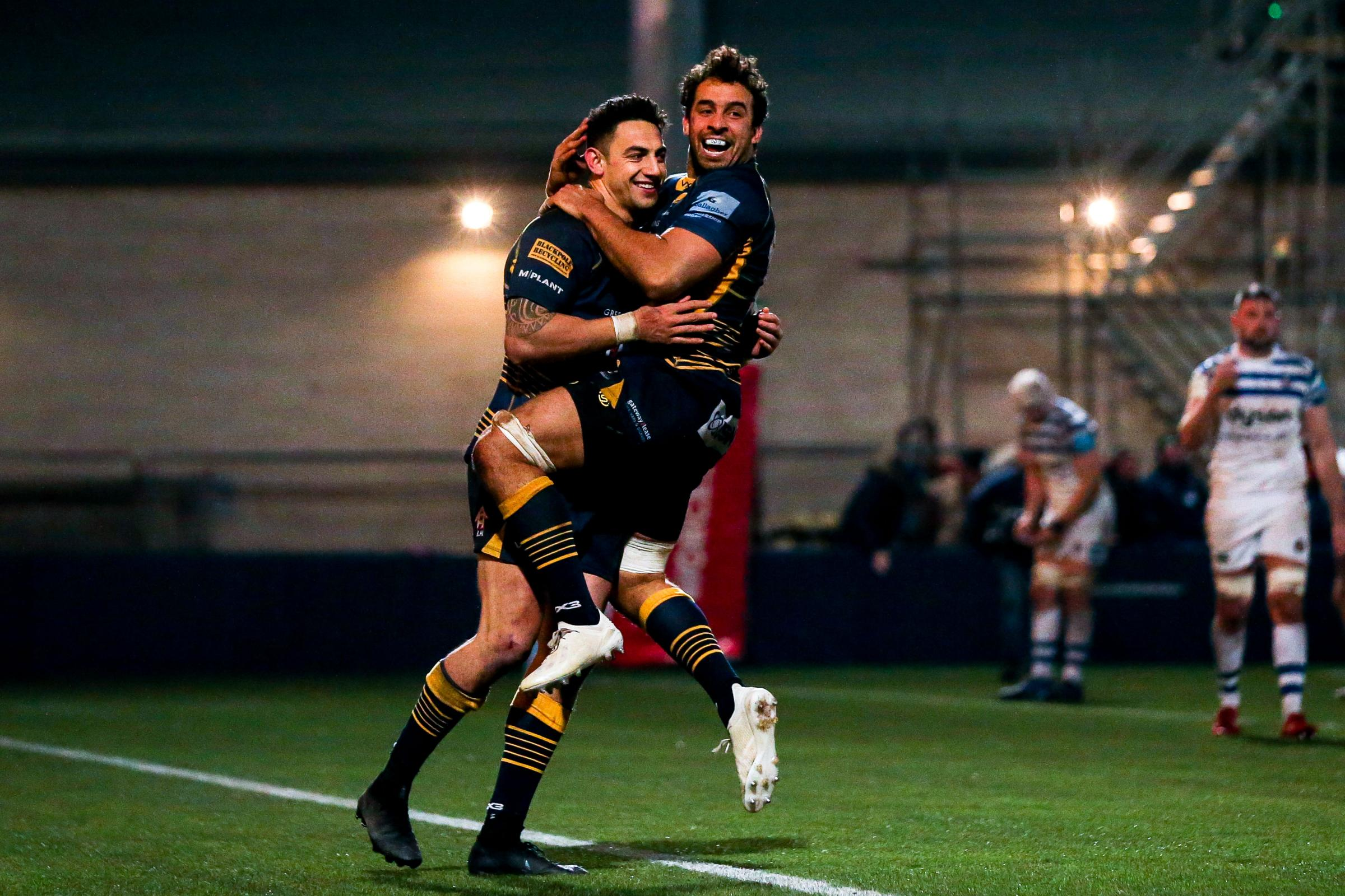 Bryce Heem is hugged by Marco Mama after scoring Warriors' second try. Picture: Robbie Stephenson/JMP
