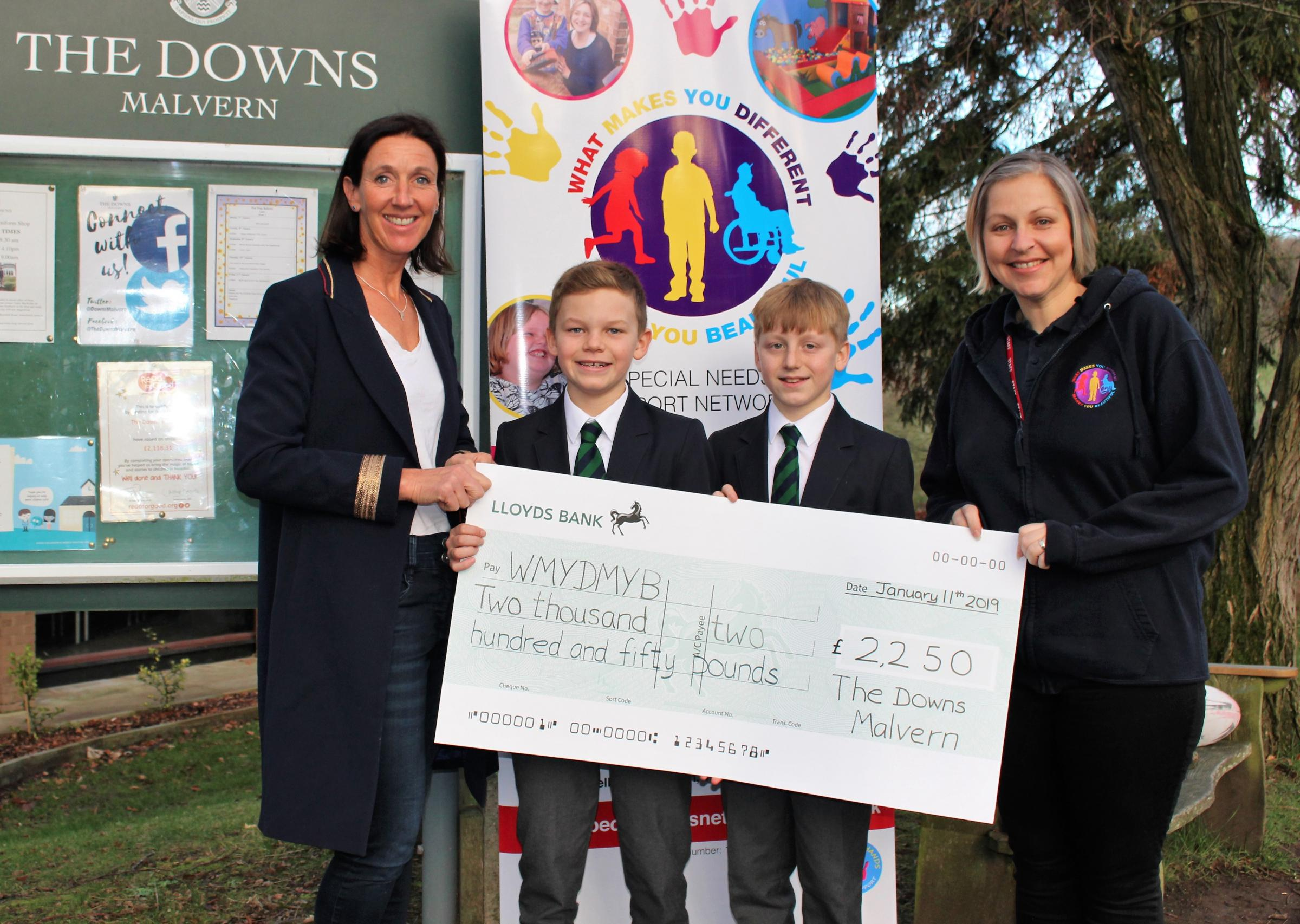 The Downs School presents a cheque to What Makes You Different Makes You Beautiful