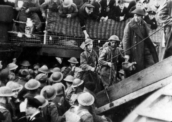DUNKIRK: British soldiers are assisted by the Royal Navy in June 1940, on their return to England after being evacuated from the beaches of Dunkirk. PA Photos