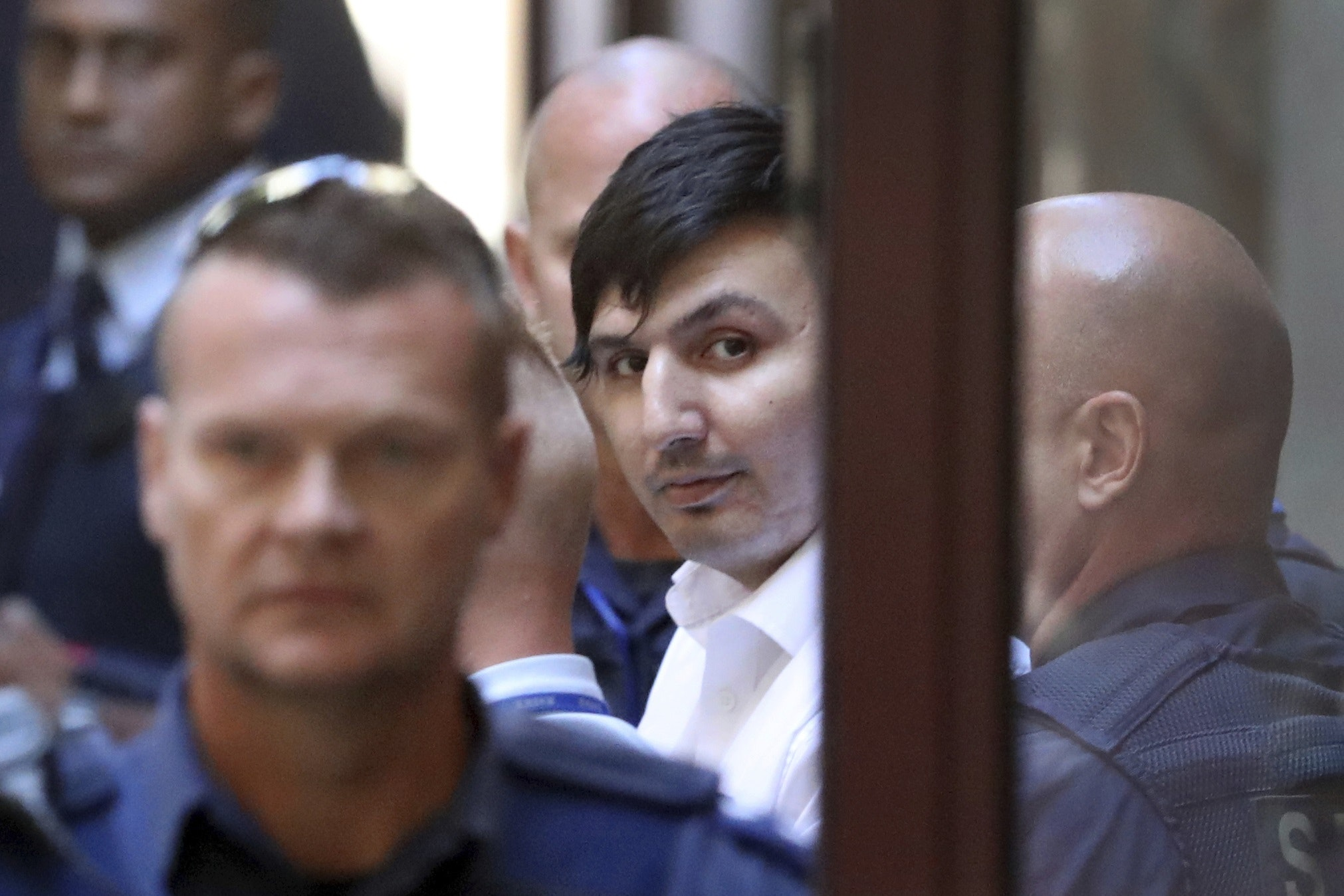 James Gargasoulas, centre, leaves the Victorian Supreme Court after sentencing, in Melbourne
