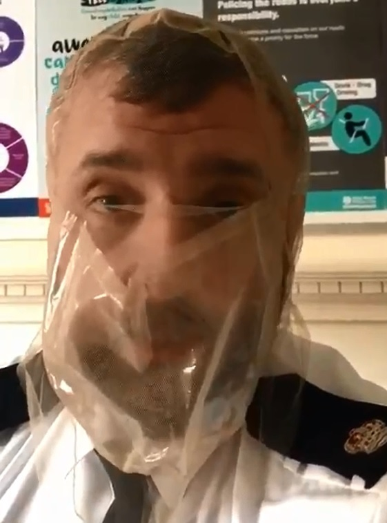 DEMONSTRATION: Damian Pettit, police commander for south Worcestershire, wearing a spit hood