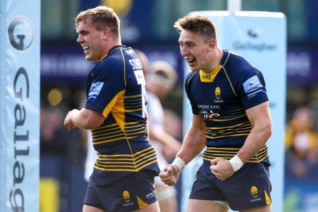 Josh Adams celebrates scoring a try for Worcester Warriors. Picture: Robbie Stephenson/JMP