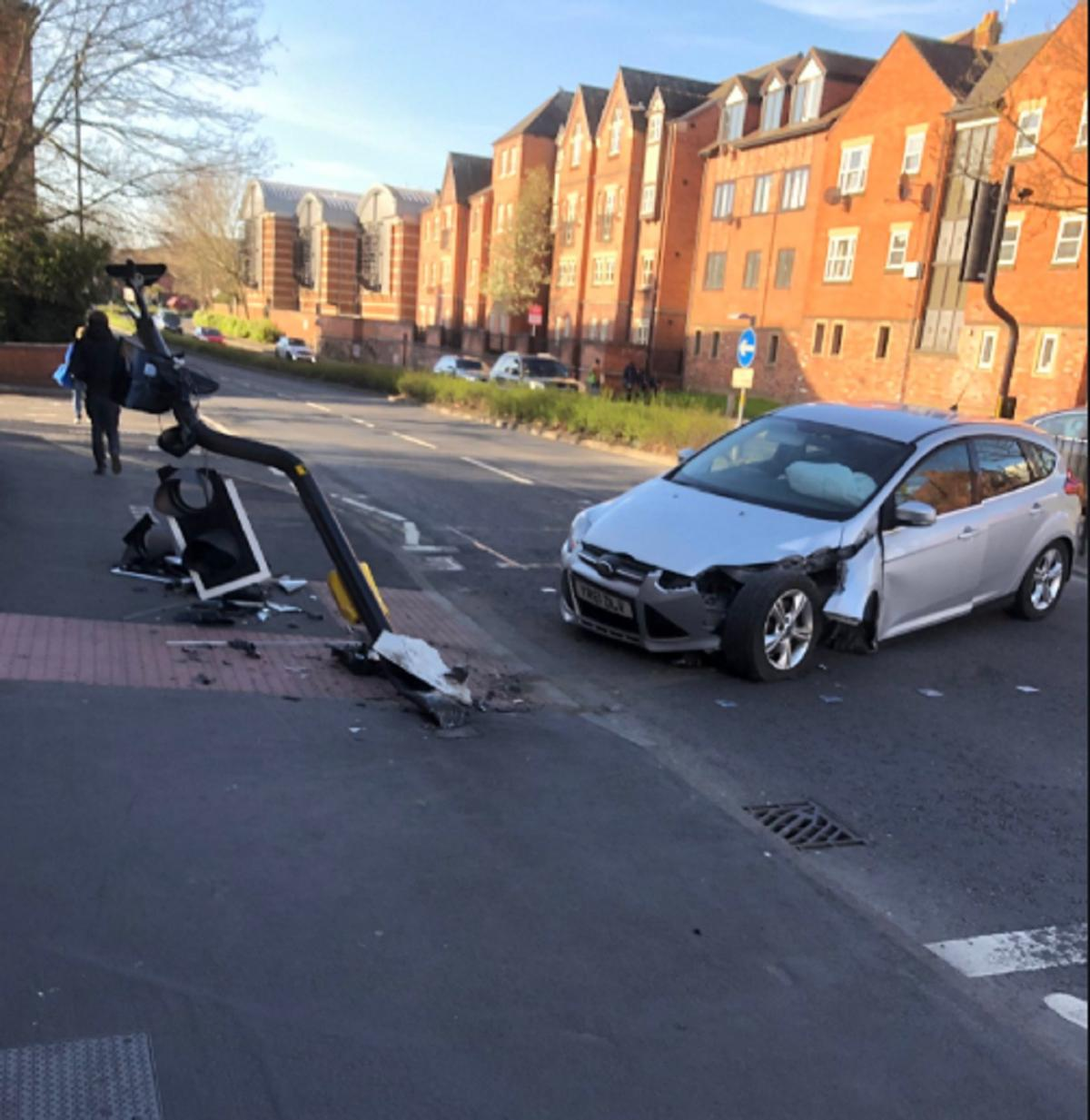 Congestion in city after car destroys traffic lights in crash