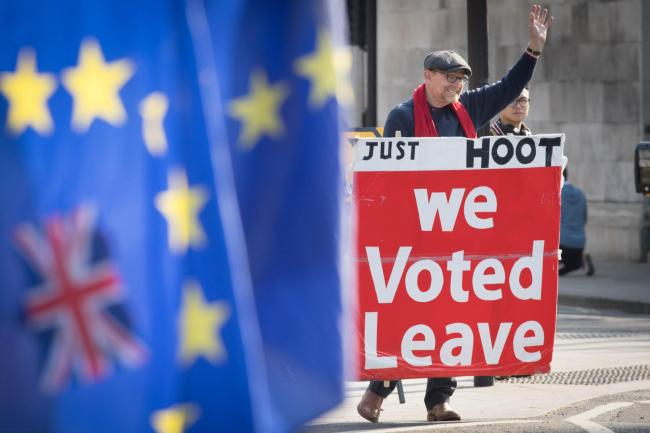 DEBATE: Leave and remain protesters outside the Houses of Parliament. Picture: Stefan Rousseau/PA Wire.