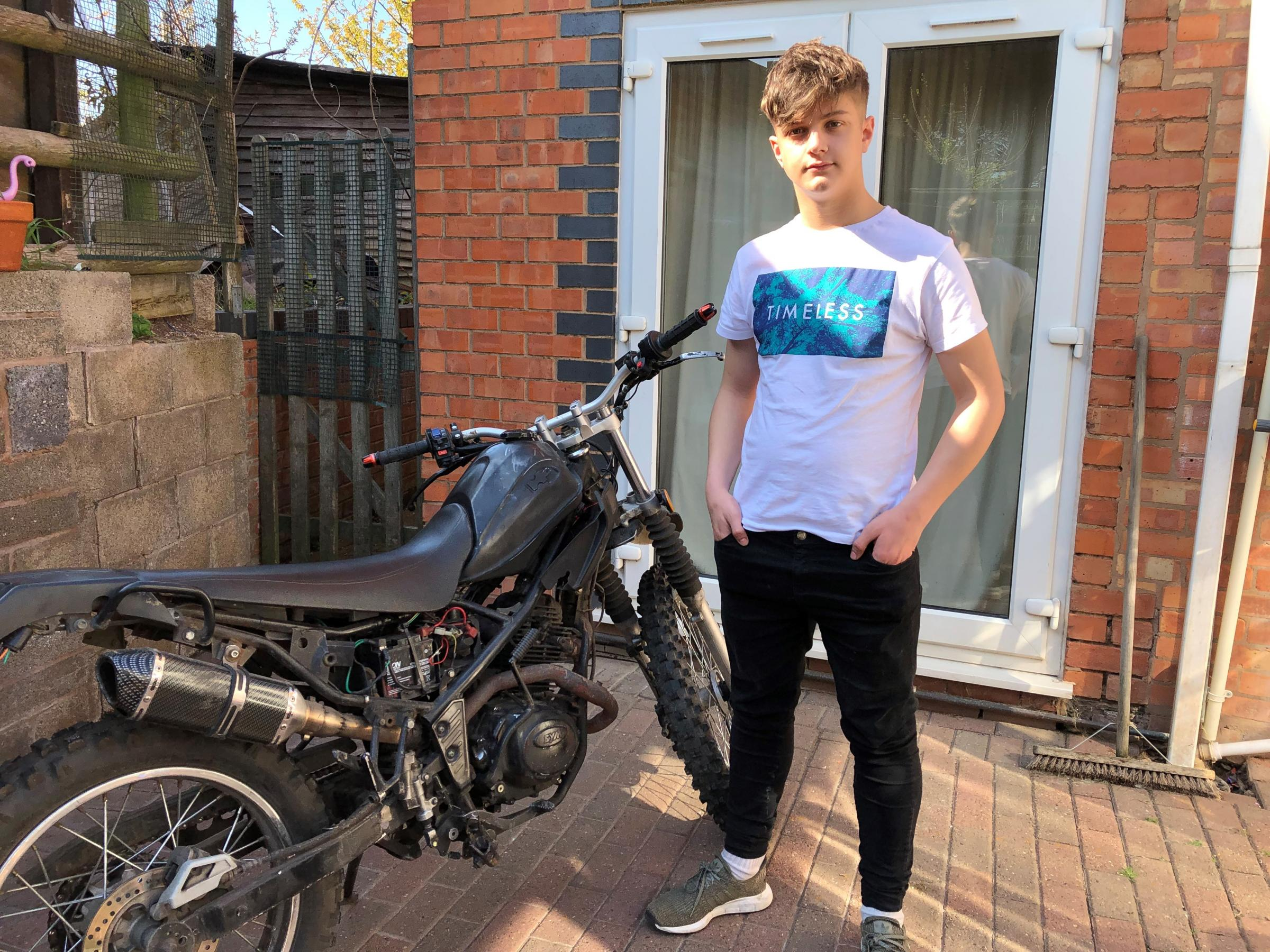 VICTIM: Mason Carr, 17, with his 'trashed' motorbike