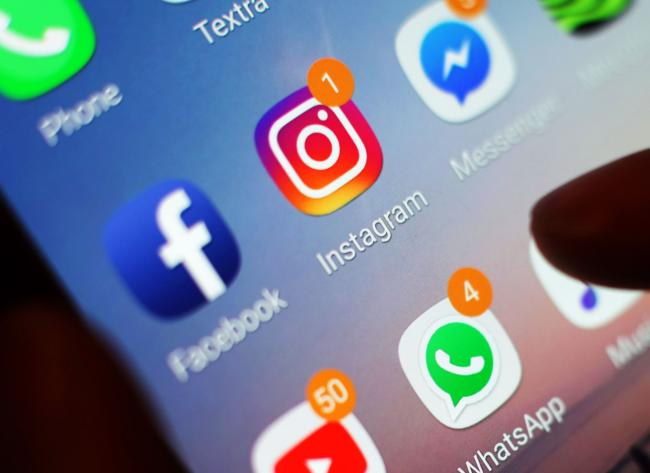 EMBARGOED TO 0001 MONDAY APRIL 15..Undated file photo of social media icons displayed on a mobile phone screen. One in four young people admits to struggling to respond to calls, texts and social media notifications, a survey has found. PRESS ASSOCIATION
