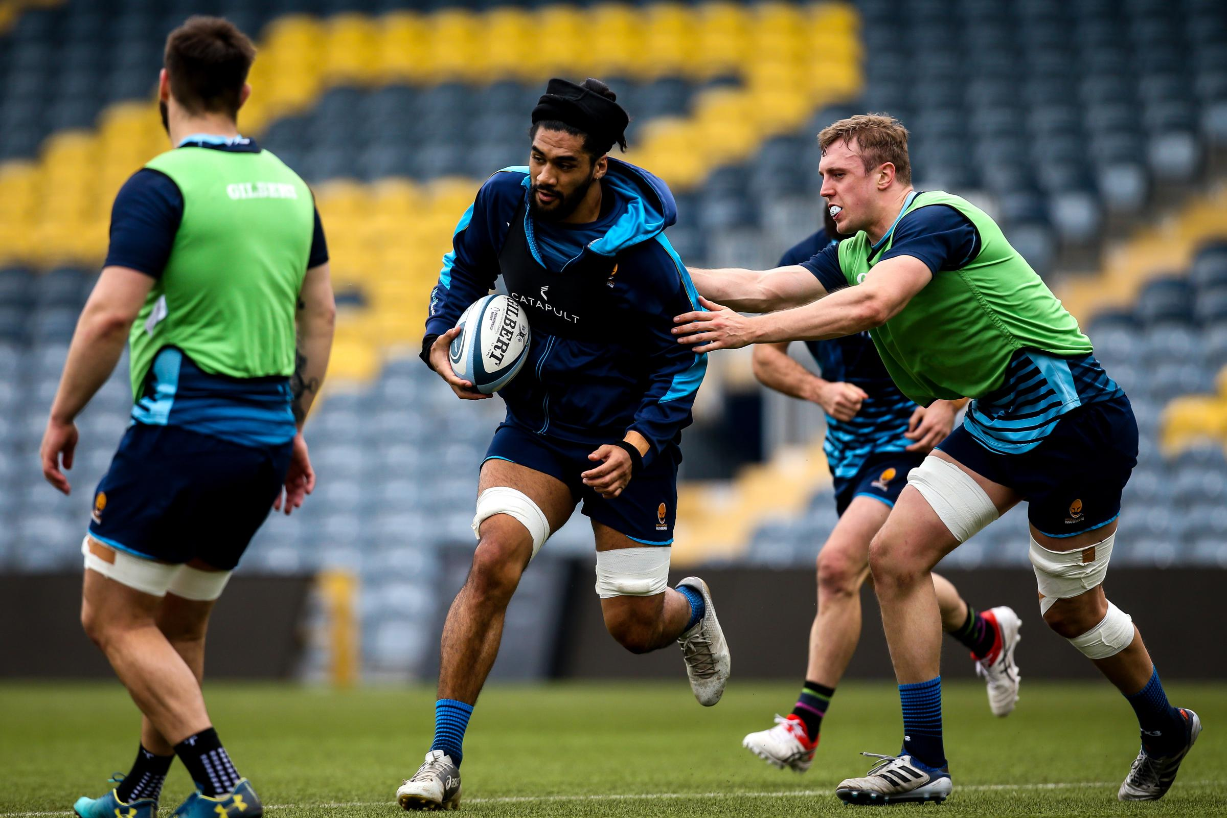 Michael Fatialofa and Pierce Phillips in training. Picture: Robbie Stephenson/JMP