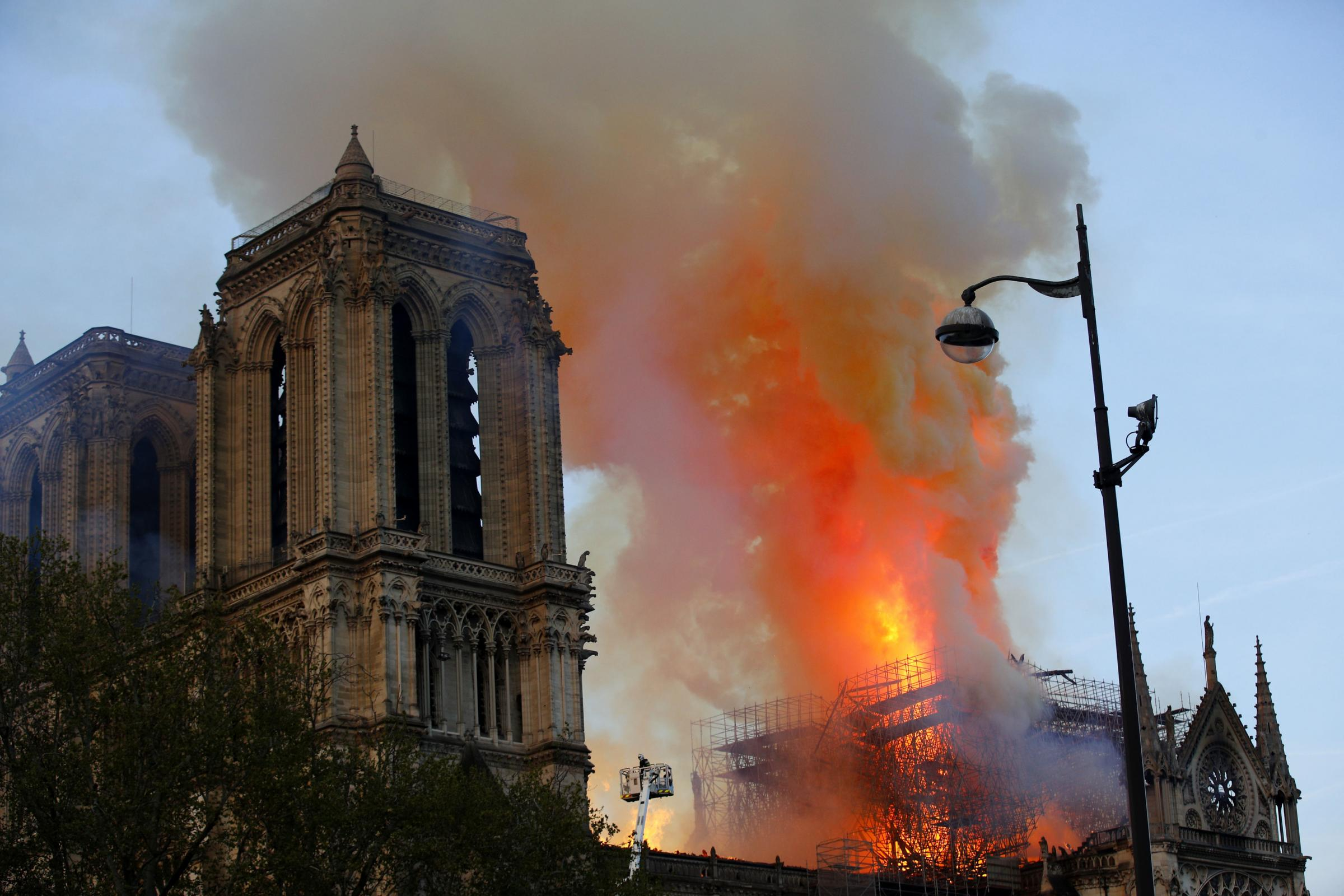 FIRE: Firefighters battle the fire at Notre Dame Cathdral in Paris on Monday. Picture: AP Photo