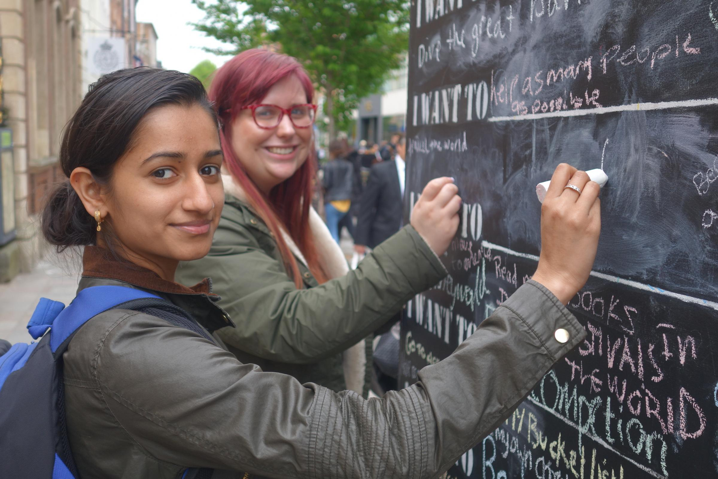 CHALK: Members of the public writing on the wall