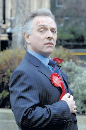 TALENTED: Rik Mayall as his TV character Alan B'Stard