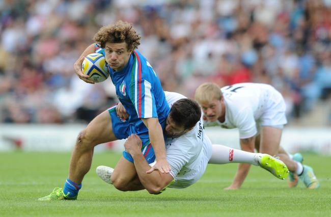 Charlie Hayter puts in a tackle against England while playing for England sevens. Picture: Dougie Allward/JMP