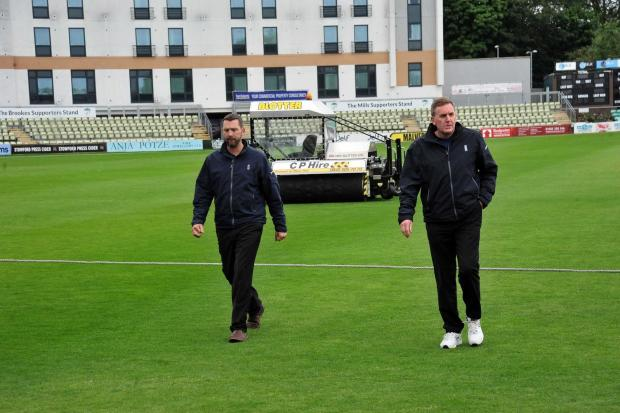 The umpires inspect the New Road pitch on day three of Worcestershire's Specsavers County Championship match. Pic Jonathan Barry 12.6.19.