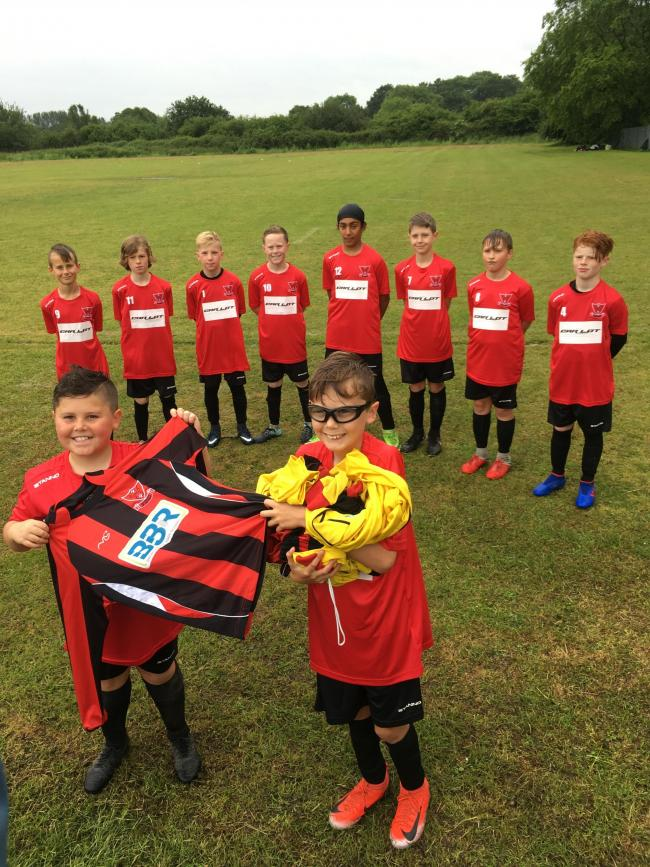 Youngsters from Catshill Under-11 Blues have donated their old kit to Kit Aid.